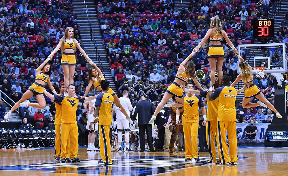 SAN DIEGO, CA - MARCH 18:  West Virginia Mountaineers cheerleaders perform during a second round game of the Men's NCAA Basketball Tournament against the Marshall Thundering Herd at Viejas Arena in San Diego, California.  (Photo by Sam Wasson)