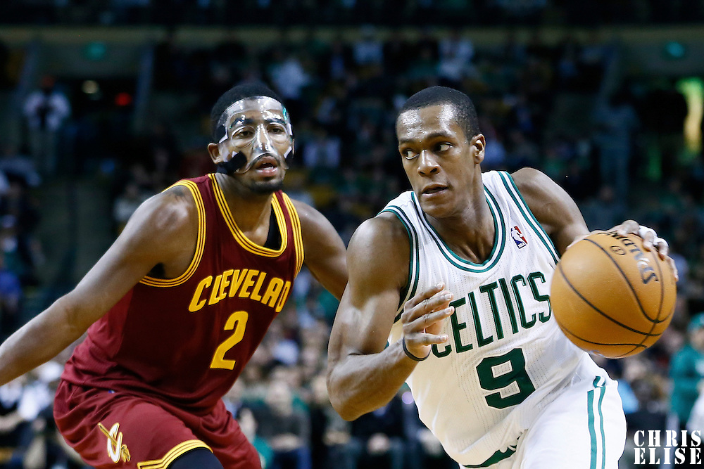19 December 2012: Boston Celtics point guard Rajon Rondo (9) drives past Cleveland Cavaliers point guard Kyrie Irving (2) during the Boston Celtics 103-91 victory over the Cleveland Cavaliers at the TD Garden, Boston, Massachusetts, USA.