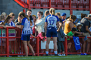 Aileen Whelan (Brighton) & Megan Connolly (Brighton) signing autographs and talking with young supporters following the FA Women's Super League match between Brighton and Hove Albion Women and Chelsea at The People's Pension Stadium, Crawley, England on 15 September 2019.
