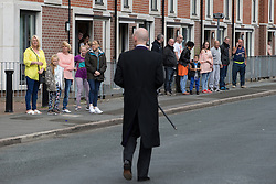 "© Licensed to London News Pictures . 28/08/2015 . Salford , UK . The procession passes along Fitzwarren Street , watched by people lining the pavements . The funeral of Paul Massey at St Paul's CE Church in Salford . Massey , known as Salford's "" Mr Big "" , was shot dead at his home in Salford last month . Photo credit : Joel Goodman/LNP"
