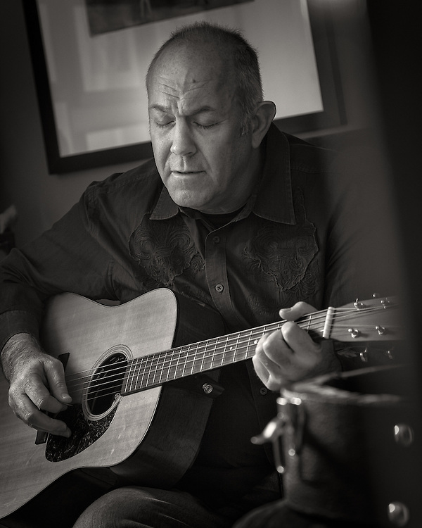 "Mark Rosenthal singing and playing the guitar at his Louisville home. Mark is a member of the Celtic group ""Cloigheann"". You will also find Mark performing with the Louisville based string band ""Dozens of Dollars""."