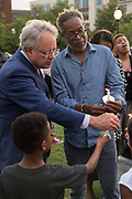 Charleston Mayor John Tecklenburg, left, lights a candle during a candlelight vigil marking the 4th anniversary of the mass shooting June 19, 2019 in Charleston, South Carolina. Nine members of the historically black congregation were gunned down during bible study by a white supremacist on June 17, 2015.