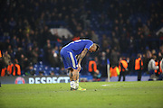 Chelsea attacker Kenedy (16) alone after loss during the Champions League match between Chelsea and Paris Saint-Germain at Stamford Bridge, London, England on 9 March 2016. Photo by Matthew Redman.