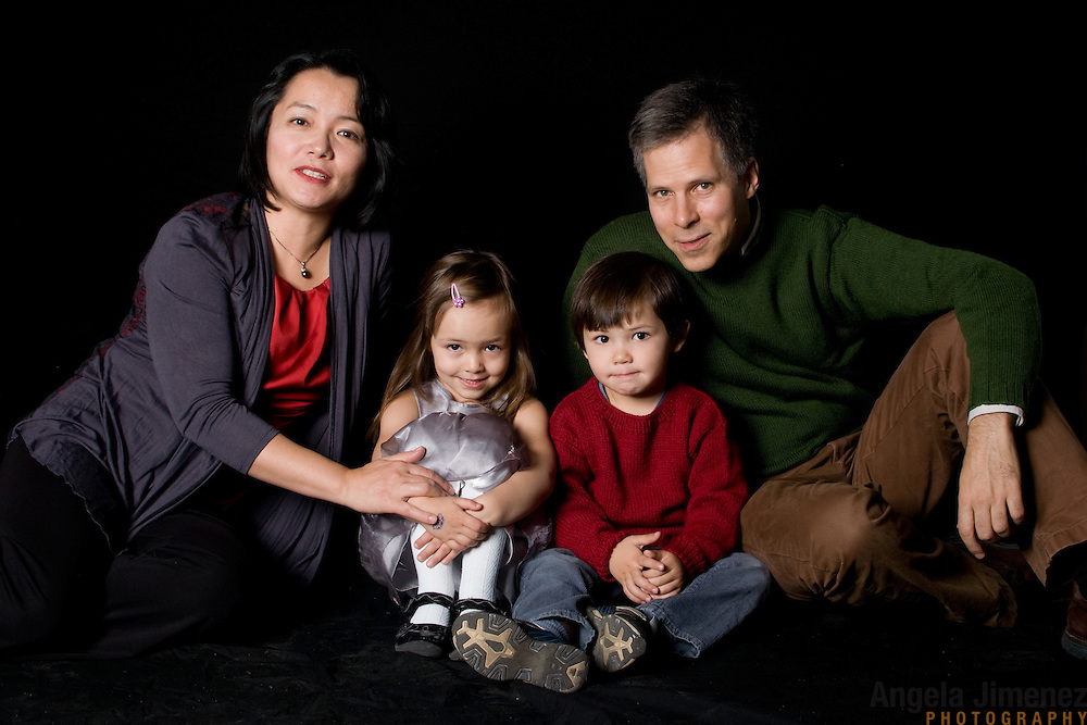 Ayako Shirasaki and family are photographed in a studio family portrait at the Brooklyn Arts Exchange for the annual holiday photo shoot fundraiser in Brooklyn, New York on November 13, 2011. ..Photo by Angela Jimenez .www.angelajimenezphotography.com