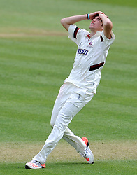 Dejection for Somerset's Jamie Overton - Photo mandatory by-line: Harry Trump/JMP - Mobile: 07966 386802 - 13/04/15 - SPORT - CRICKET - LVCC County Championship - Day 2 - Somerset v Durham - The County Ground, Taunton, England.