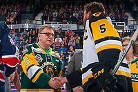 REGINA, SK - MAY 25: The Father of the late Dayna Borns, athletic therapist of the Humboldt Broncos shake the hand of Justin Lemcke #5 of Hamilton Bulldogs at the Brandt Centre on May 25, 2018 in Regina, Canada. (Photo by Marissa Baecker/CHL Images)
