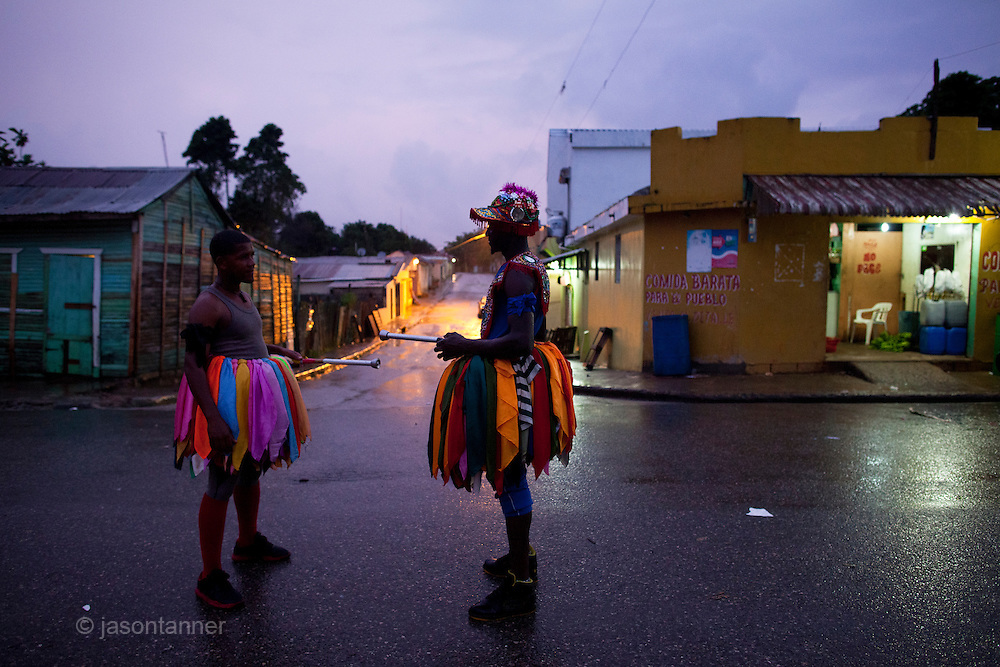 Dominican Republic: Two Mayores talk at a crossroads  as part of the GaGá  procession of El GaGá de San Luis....