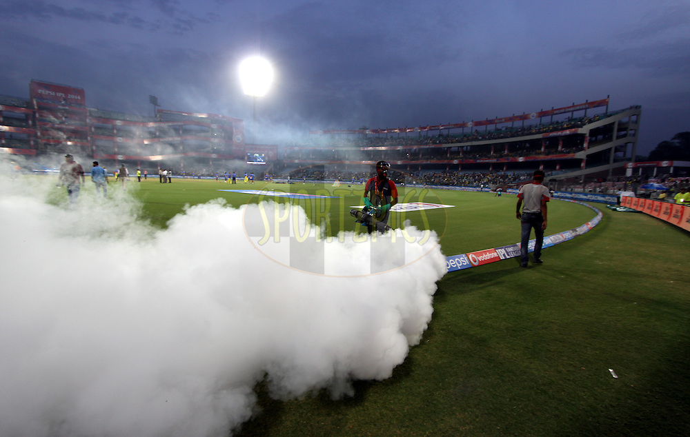 A ground staff spray during match 26 of the Pepsi Indian Premier League Season 2014 between the Delhi Daredevils and the Chennai Superkings held at the Ferozeshah Kotla cricket stadium, Delhi, India on the 5th May  2014<br /> <br /> Photo by Arjun Panwar / IPL / SPORTZPICS<br /> <br /> <br /> <br /> Image use subject to terms and conditions which can be found here:  http://sportzpics.photoshelter.com/gallery/Pepsi-IPL-Image-terms-and-conditions/G00004VW1IVJ.gB0/C0000TScjhBM6ikg