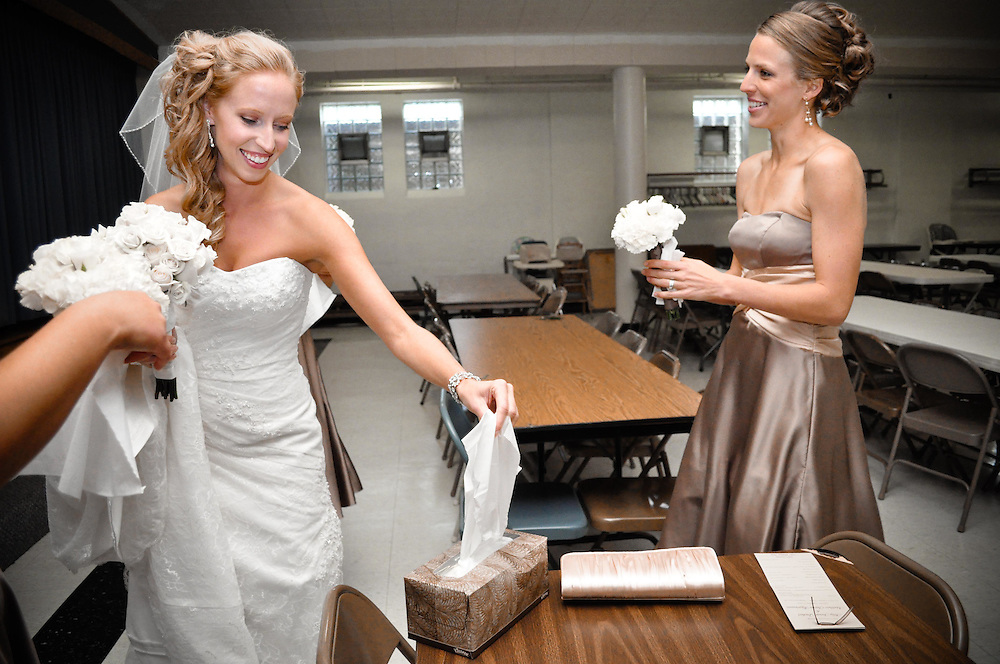 Abby and her bridesmaids stock up on tissues in preparation for a teary ceremony at St. Mary's Catholic Church, Richland Center, WI