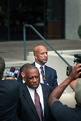 09 July 2014. New Orleans, Louisiana. <br /> A forlorn Ray Nagin, former mayor of New Orleans and his attorney Robert Jenkin's leave Federal Court in New Orleans following Nagn's sentencing hearing. Nagin was sentenced to serve 10 years in prison for bribery and money laundering. <br /> Photo; Charlie Varley/varleypix.com