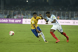 October 25, 2017 - Kolkata, West Bengal, India - England Callum Hudson-Odoi (jersey 14) and Brazil Wesley (jersey 2) in action during the FIFA U 17 World Cup India 2017 Semi Final match in Kolkata. Players of England and Brazil in action during the FIFA U 17 World Cup India 2017 Semi Final match on October 25, 2017 in Kolkata. (Credit Image: © Saikat Paul/Pacific Press via ZUMA Wire)