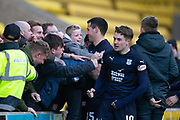 16th February 2019, Tony Macaroni Arena, Livingston, Scotland; Ladbrokes Premiership football, Livingston versus Dundee; Ryan McGowan of Dundee rescues a child from the crush as Scott Wright celebrates his winner wiht the fans