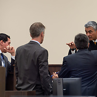 Judge James Sanchez brings the counsel to the bench Monday morning of the Green trial at the 13th Judicial District Courthouse in Grants.