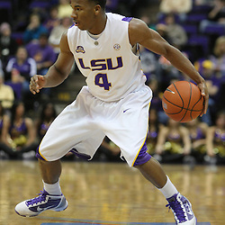 Jan 04, 2010; Baton Rouge, LA, USA;  LSU Tigers guard Chris Bass (4) controls the ball against the McNeese State Cowboys during the first half at the Pete Maravich Assembly Center.  Mandatory Credit: Derick E. Hingle-US PRESSWIRE
