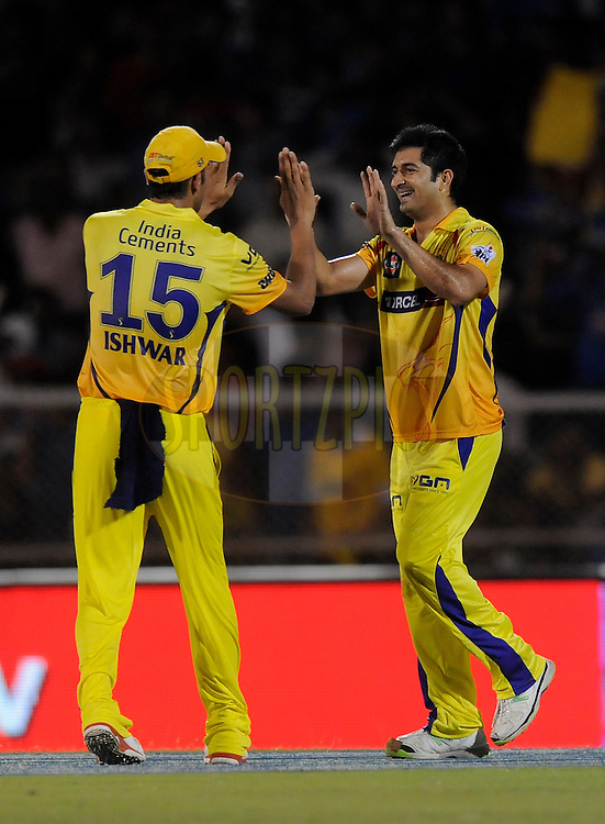 Mohit Sharma of The Chennai Superkings celebrates the wicket of Kieron Pollard of the Mumbai Indians during the eliminator match of the Pepsi Indian Premier League Season 2014 between the Chennai Superkings and the Mumbai Indians held at the Brabourne Stadium, Mumbai, India on the 28th May  2014<br /> <br /> Photo by Pal PIllai / IPL / SPORTZPICS<br /> <br /> <br /> <br /> Image use subject to terms and conditions which can be found here:  http://sportzpics.photoshelter.com/gallery/Pepsi-IPL-Image-terms-and-conditions/G00004VW1IVJ.gB0/C0000TScjhBM6ikg