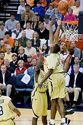 Virginia forward Jamil Tucker (12) shoots over Georgia Tech forward Gani Lawal (31).  The Virginia Cavaliers men's basketball team fell to the Georgia Tech Yellow Jackets 92-82 in overtime at the John Paul Jones Arena in Charlottesville, VA on January 27, 2008.