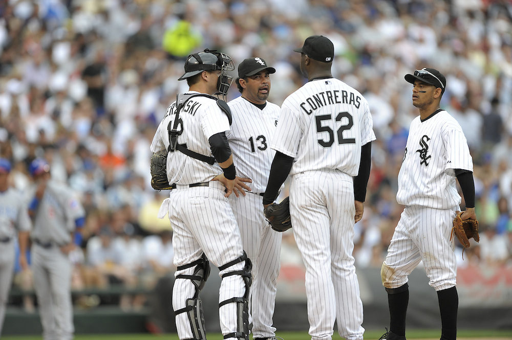 CHICAGO - JUNE 27:  Manager Ozzie Guillen #13 of the Chicago White Sox has an animated discussion with Jose Contreras #52 after Contreras got into trouble during the game against the Chicago Cubs at U.S. Cellular Field in Chicago, Illinois on June 27, 2008.  The White Sox defeated the Cubs 10-3.  (Photo by Ron Vesely)