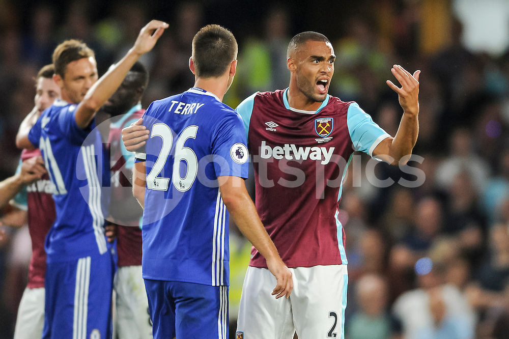 John Terry of Chelsea and Winston Reid of West Ham United during the Premier League match between Chelsea and West Ham United at Stamford Bridge, London, England on 15 August 2016. Photo by Salvio Calabrese.