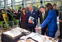 The Prince of Wales (second left) and Colombian President Juan Manuel Santos (second right) are shown a natural history display by Professor Kathy Willis, Director of Science at the Royal Botanic Gardens in Kew (left), in the Darwin Centre at the Natural History Museum in London.
