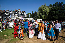 © Licensed to London News Pictures. 02/09/2018. Aldenham, UK. Workshipers queue to enter Bhaktivedanta Manor, Hare Krishna Temple in Aldenham, Hertfordshire during celebrations for the Janmashtami festival. Janmashtami is an annual Hindu festival that celebrates the birth of Krishna. Bhaktivedanta Manor, the venue fo the event, was donated to the Hare Krishna movement in February 1973 by former Beatle George Harrison. Photo credit: Ben Cawthra/LNP