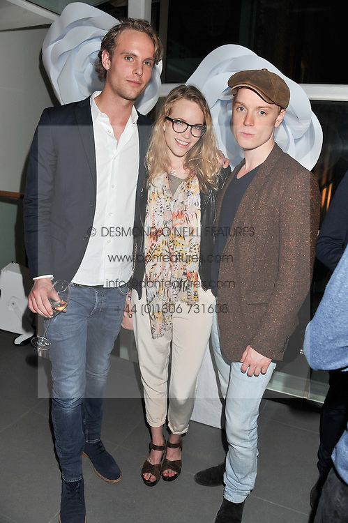 Left to right, JACK FOX, TAMZIN MERCHANT and FREDDIE FOX at a party hosted by Ines de la Frassange and Bruno Frisoni for Roger Vivier to launch the Roger Vivier book held at The Saatchi Gallery, London on 24th April 2013.