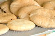Freshly baked pita bread in a bakery