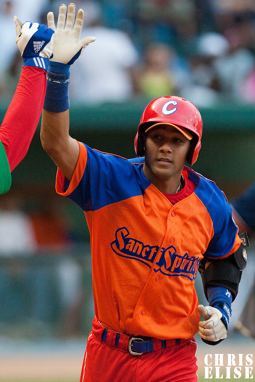 15 February 2009: Third base Yulieski Gourriel is seen after hitting an homerun during a training game of Cuba Baseball Team for the World Baseball Classic 2009. The national team is pitted against itself, divided in two teams called the Occidentales and the Orientales. The Orientales win 12-8, at the Latinoamericano stadium, in la Habana, Cuba.