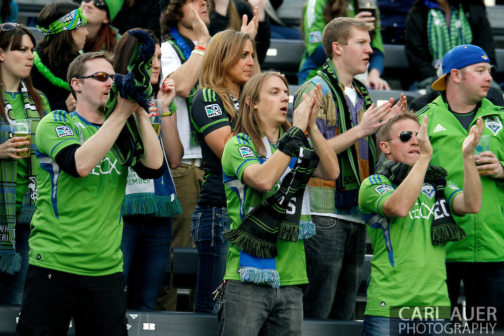 April 20th, 2013 Commerce City, CO - Seattle fans cheer during the second half of the MLS match between the Seattle Sounders FC and the Colorado Rapids at Dick's Sporting Goods Park in Commerce City, CO