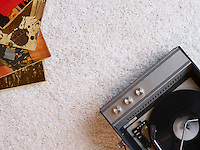 Record player and vinyl records on floor view from above
