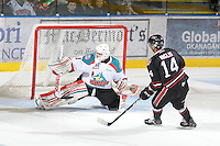 KELOWNA, CANADA - FEBRUARY 18: Adam Brown #14 of the Kelowna Rockets makes a save against Charles Inglis #14 of the Red Deer Rebels during the shoot out at the Kelowna Rockets on February 18, 2012 at Prospera Place in Kelowna, British Columbia, Canada (Photo by Marissa Baecker/Shoot the Breeze) *** Local Caption ***