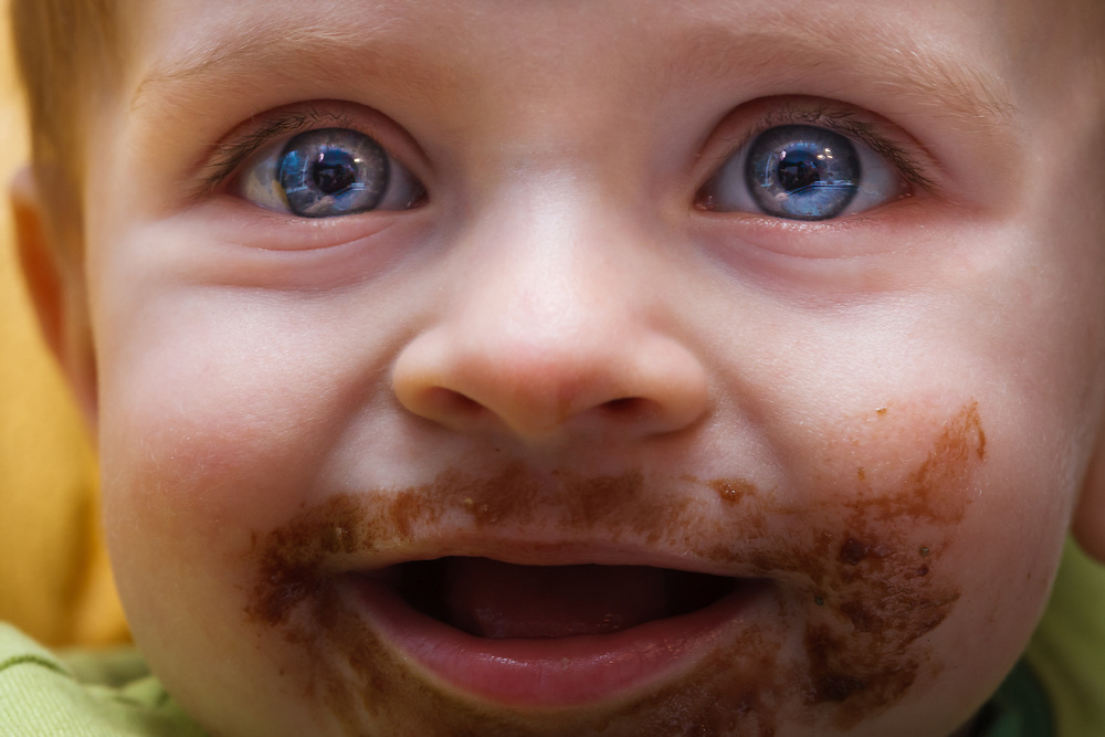 Micah Goodrich stares at his father while eating chocolate cake in La Conner Washington.
