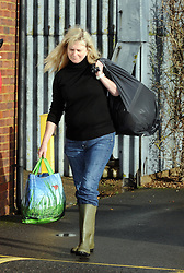 © Licensed to London News Pictures. 06/01/2014<br /> Little Venice resident carrying her belongings in bags off the site.<br /> Yalding village Flood water starts receding again as a clear up operation starts.<br /> The village in Kent also gets a visit from the new Kent Police Chief Constable Alan Pughsley and Kent Police Commissioner Ann Barnes who walked around Little Venice Country Park meeting residents.  Alan Pughsley has been in the post since January 4th 2014.<br /> Photo credit :Grant Falvey/LNP