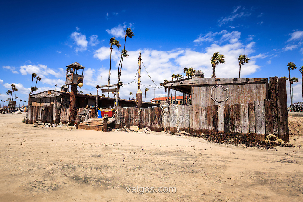 Photo of Dory Fishing Fleet Market in Newport Beach California. The Dory Fleet is a group of fisherman that operate from the Dory Fish Market by the Newport Pier and sell the catch of the day from the Pacific Ocean. The Dory Fleet is a landmark in Orange County California.