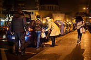 Two migrant women with two little grls enter a car of a stranger who allegedly will help them cross the Spanish-French border. Irun (Basque Country). March 14, 2019. A group of volunteers has created a host network to serve migrants and inform about the public services they are entitled to and the ways to cross the border. This group of volunteers is avoiding a serious humanitarian problem Irun, the Basque municipality on the border with Hendaye. As the number of migrants arriving on the coasts of southern Spain incresead, more and more migrants are heading north to the border city of Irun. French authorities have reacted by conducting random checks as far as the city of Bordeaux, more than 200 kilometers north of the border. Migrants who are caught are then deported back to Irun. (Gari Garaialde / Bostok Photo).