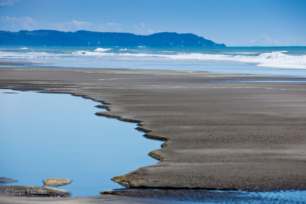 At low tide the sand exposes patterns and shapes in a shallow lagoon in New Zealand's North Island.  The northern coast bordering on the Bay of Plenty have extensive uncrowded beaches and spectacular coastline that offer solitude and sunshine.