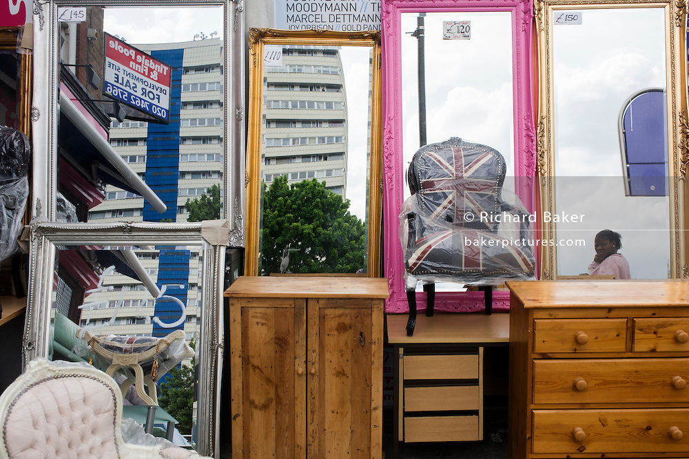 Furniture and chair in the colours of the Union Jack on sale in an outside shop in south London.