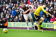 Burnley defender Charlie Taylor tackled by Arsenal defender Héctor Bellerín  during the Premier League match between Burnley and Arsenal at Turf Moor, Burnley, England on 2 February 2020.