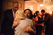 "Photo by Matt Roth.Assignment ID: 10137379A..Senator Patrick Leahy (D-VT) stands in the background while Susan Rice, the United States U.N. ambassador hugs Marycelle Leahy during Buffy and Bill Cafritz, Ann and Vernon Jordan, Vicki and Roger Sant's inaugural ""Bi-Partisan Celebration"" at the Dolley Madison Ballroom at the Madison Hotel in Washington, D.C. on Sunday, January 20, 2013."