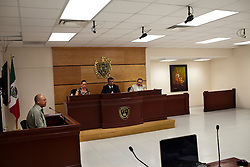 A police officer testifies about ballistics during the trial of a hitman in Ciudad Juarez.  The majority of murders in Ciudad Juarez go unsolved, creating a culture of impunity that fuels the increasing violence.