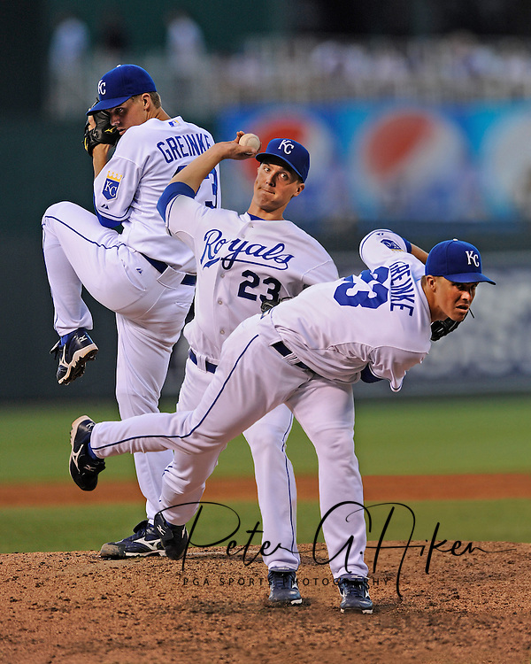 Photo Illustration -- Starting pitcher Zack Greinke #23 of the Kansas City Royals delivers a pitch during a game against the Chicago White Sox at Kauffman Stadium in Kansas City, Missouri. .