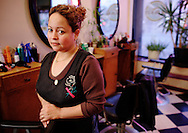 Martha Gomez inside her salon, Martha's Unisex at 2117 N. Western in Chicago, IL.  She was fighting against competition from illegally setup salons down the block. .
