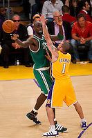 17 June 2010: Forward Kevin Garnett of the Boston Celtics passes the ball while being guarded by Jordan Farmar of the Los Angeles Lakers during the first half of the Lakers 83-79 championship victory over the Celtics in Game 7 of the NBA Finals at the STAPLES Center in Los Angeles, CA.