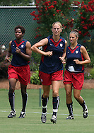 29 July 2006: Marci Miller (USA) (center) jogs around the field flanked by Briana Scurry (USA) (l) and Carli Lloyd (USA) (r). The United States Women's National Team trained at SAS Stadium in Cary, North Carolina, in preparation for an International Friendly match against Canada to be played on Sunday, July 30.