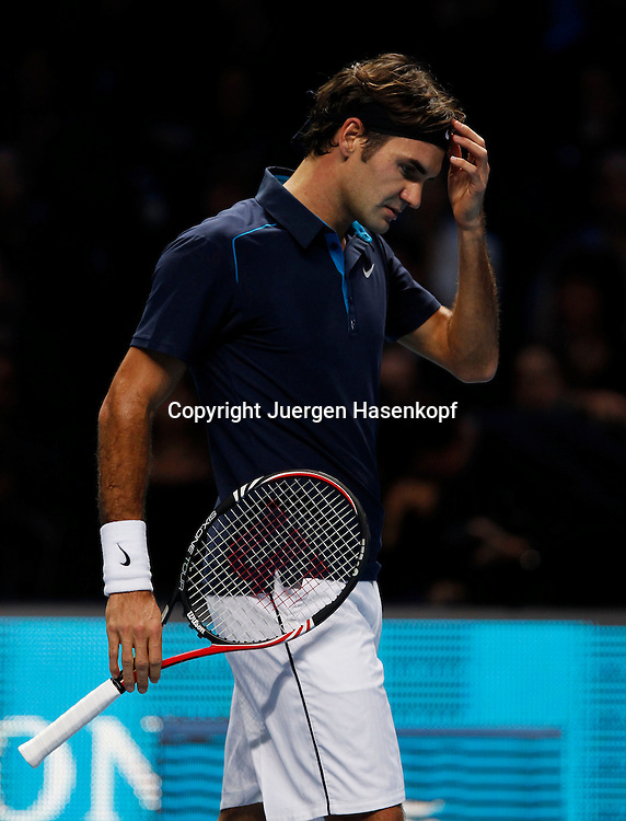 ATP World Tour Finals  2011 in der O2 Arena in London, HerrenTennis Turnier, WM, Weltmeisterschaft, Roger Federer (SUI),.Einzelbild,Halbkoerper,Hochformat,