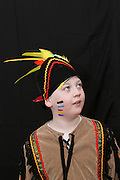 A boy of 8 dresses up as a Red Indian