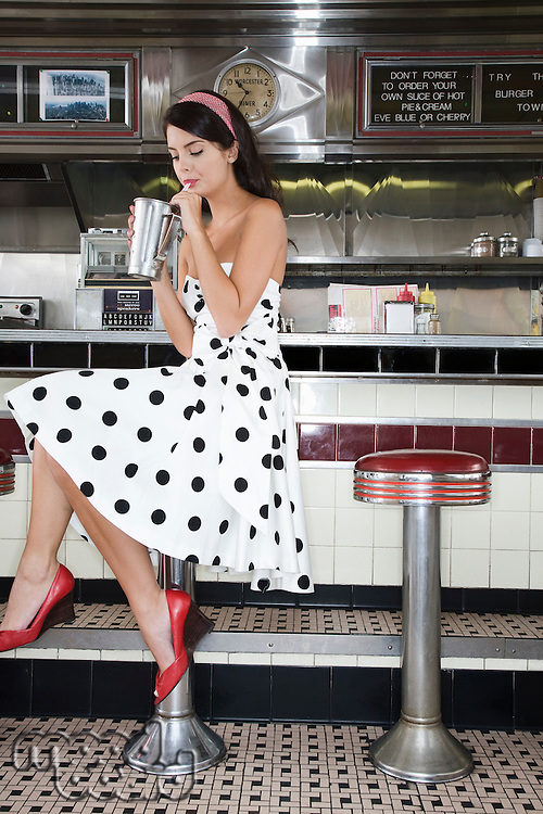 Young Woman Drinking a Shake in a Diner