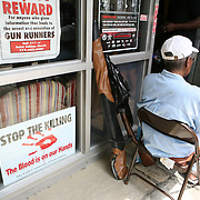 The Chicago Police Department sponsored Don't Kill a Dream Save a Life, a no questions asked gun turn in program to reduce the number of weapons in Chicago Saturday June 23, 2012. The guns were accepted at 23 city churches in exchange for a $50 credit card.A line formed outside Saint Sebaina Church to turn guns in for cash.. Jose More Photography                                **Files available in RAW format**