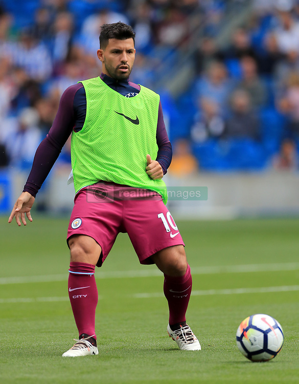 Manchester City's Sergio Aguero warms up prior to the Premier League match at the AMEX Stadium, Brighton.