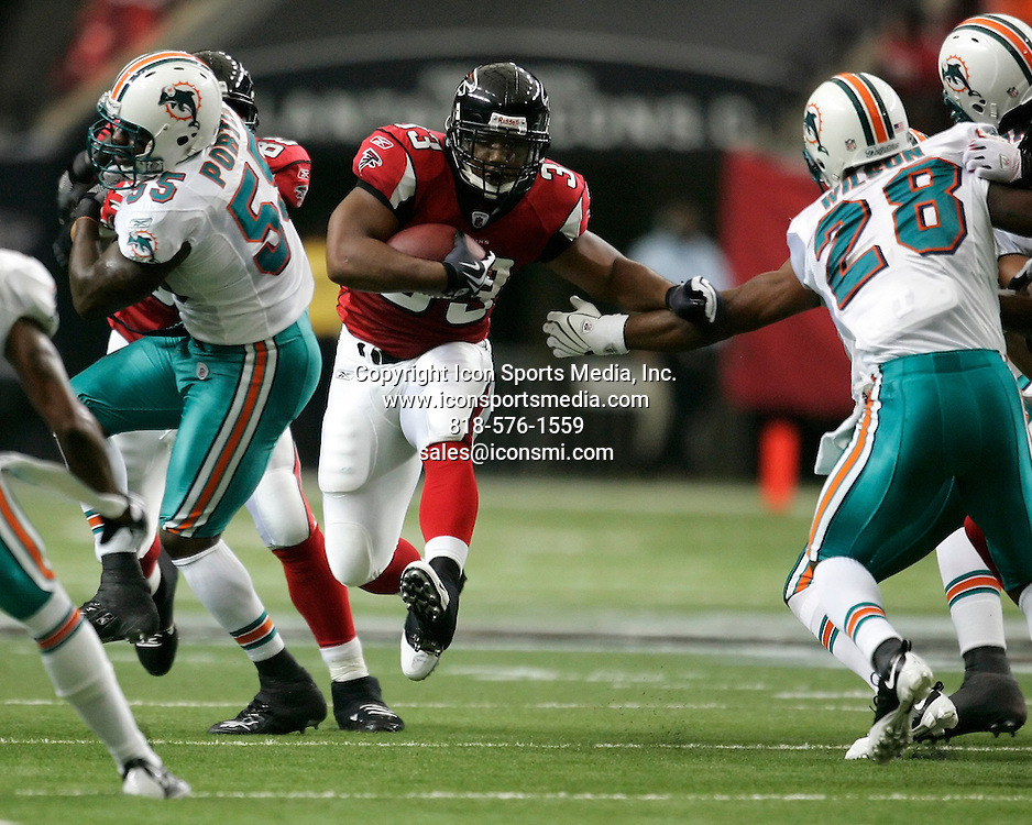 13 September 2009: Atlanta Falcons running back Michael Turner (33) rushes in the Atlanta Falcons 19-7 victory over the Miami Dolphins at the Georgia Dome in Atlanta Georgia.