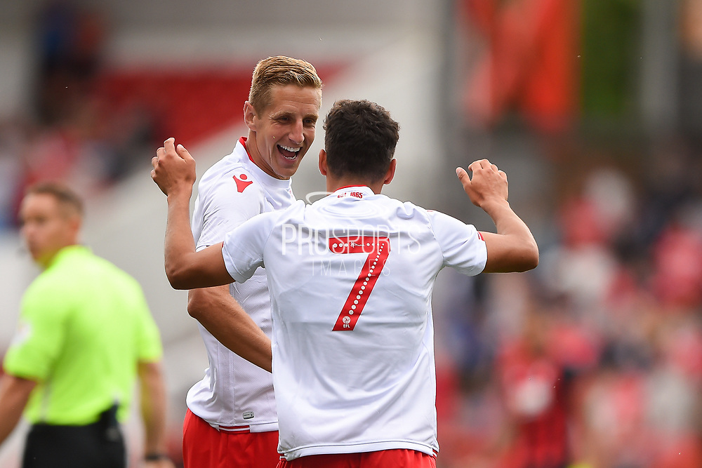 Nottingham Forest defender Michael Dawson (5) celebrates with Nottingham Forest forward Gil Dias (7) after scoring Forest's second gaol to make it 2-0 during the Pre-Season Friendly match between Nottingham Forest and Bournemouth at the City Ground, Nottingham, England on 28 July 2018. Picture by Jon Hobley.